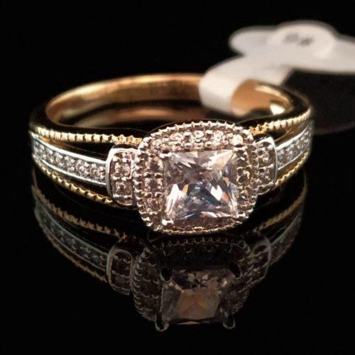 Кольцо позолоченное золото 585 пробы с цирконом